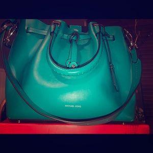 Micheal Kors Turquoise Handbag.